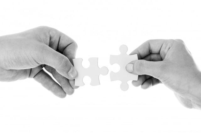 black-and-white-studio-shot-of-hands-holding-jigsaw.jpg